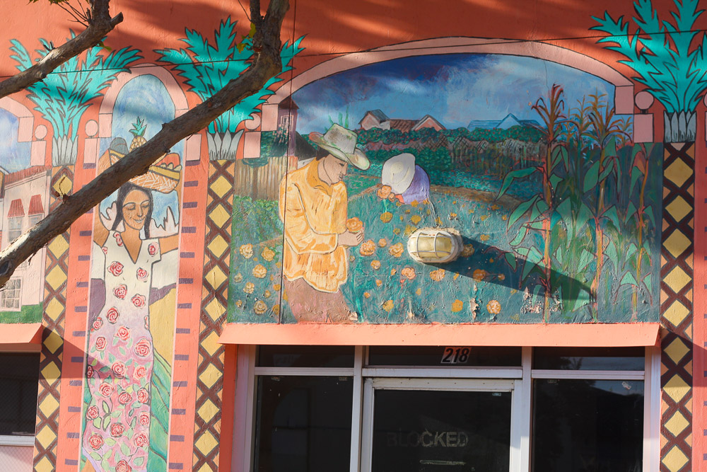 A mural several blocks away depicts neighbors tending the Beach Flats Community Garden.