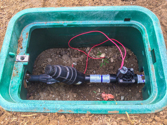 Excavating and installing automated irrigation